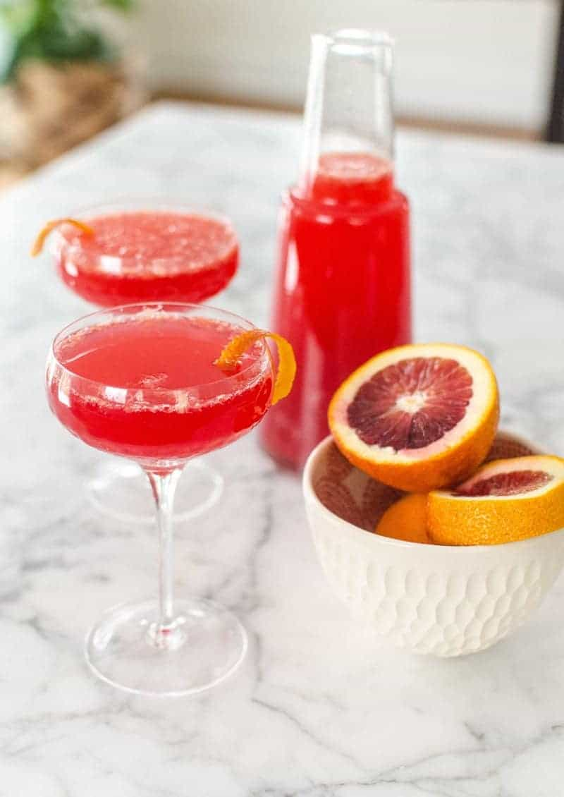 blood-orange-mimosa. A party isn't a party without some crowd pleasing cocktails. Save your sanity at your next party by having a few of these make-ahead big batch cocktails mixed and ready to serve. Click here to check out these delicious big batch cocktail recipes now.