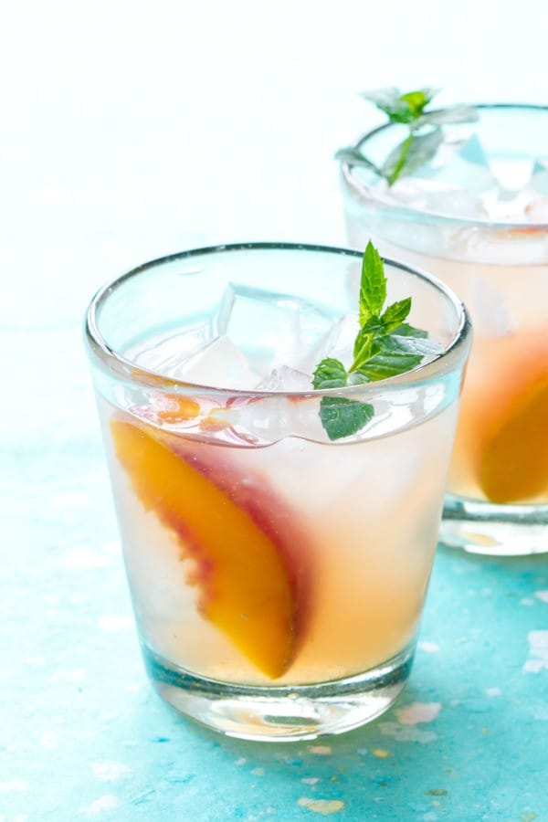 Bourbon-peach-lemonade. A party isn't a party without some crowd pleasing cocktails. Save your sanity at your next party by having a few of these make-ahead big batch cocktails mixed and ready to serve. Click here to check out these delicious big batch cocktail recipes now.