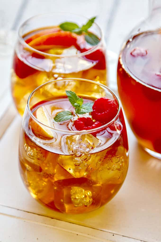 Sweet-tea-sangria-with-peaches. A party isn't a party without some crowd pleasing cocktails. Save your sanity at your next party by having a few of these make-ahead big batch cocktails mixed and ready to serve. Click here to check out these delicious big batch cocktail recipes now.