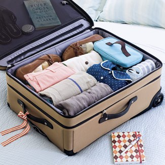 Roll Your Clothes - These indispensable travel packing tips we've assembled will make your packing and unpacking much more efficient and help you stay super organized while on vacation. Now you're set to travel like a pro!