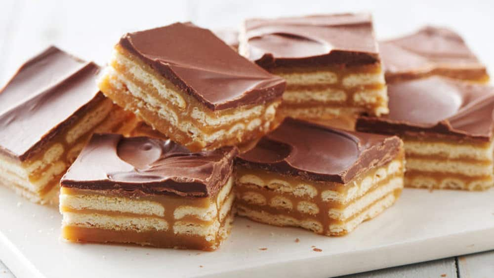 Triple Layer Cracker Toffee Bars - Check out our list of 20 of the best easy desserts to feed a crowd. Be prepared for empty dishes and a round of applause when you bring one of these recipes to your next event.