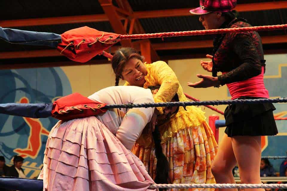cheap place to fly and see Cholita wrestling in Bolivia