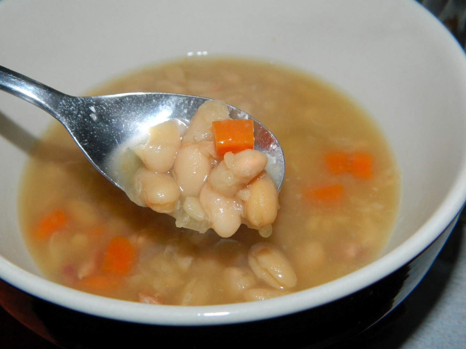 Navy Bean and Ham Soup - Canning homemade soups can help you save money, gain control over what's in your food, and save you time when you need a quick meal. Make your own canned soup with one of these delicious twelve recipes today.