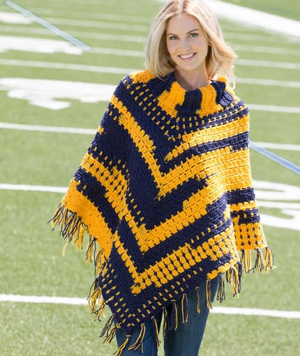 Sporty Poncho - If you want to learn how to make a poncho, this list of 18 free crochet poncho patterns will help you. Pick your favorite from this bunch and start creating. #CrochetPonchoPatterns #FreeCrochetPatterns #CrochetAddict