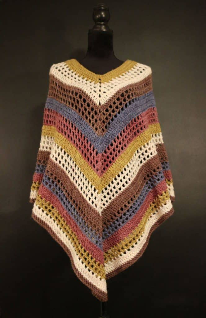 The Easiest Poncho You'll Ever Make - If you want to learn how to make a poncho, this list of 18 free crochet poncho patterns will help you. Pick your favorite from this bunch and start creating. #CrochetPonchoPatterns #FreeCrochetPatterns #CrochetAddict